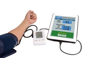 Someone is checking his health information using blood measurement meters link to e-health application by tablet.